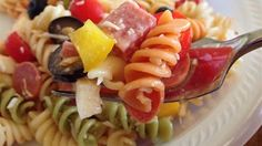 This pasta salad, made with Provolone, salami, pepperoni, bell peppers, and black olives tossed with fusili pasta and Italian salad dressing, is very easy to make.