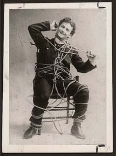 ...photo of a young Houdini escaping from a roped chair...