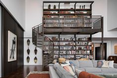 Custom-made bookshelf with a spiral staircase in a Chicago penthouse [2364x1577] - Imgur