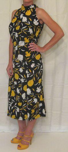 handmade vintage  http://www.ebay.com/itm/Vtg-70s-80s-HANDMADE-shirt-dress-DRAPING-high-neck-Sleeveless-boho-hippie-M-/200818546742?pt=Vintage_Women_s_Clothing=item2ec1b7d836