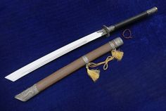 """Item Specification: Material:High carbon steel; Sword Type:Hand Made Sword; Package weight:2KG; Overall Length:38""""/96cm; Blade Length:20""""/50CM; Scabbard:Rosewood; Handle:Wood,Antiskid rope winding; Knife fitted:Zinc-alloy; Condition:Brand New; Origin:Longquan Zhejiang China; Accessories:Cotton sword bag."""