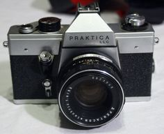 Have one to sell? Sell it yourself  Praktica LLC Vintage Camera 2 screwmount lenses 2x converter and meter is untested
