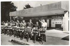 Postmen outside Aranui Post Office 20 January 1965 A group of postmen on bicycles with baskets of mail outside the entrance to Aranui Post Office on Pages Road, Aranui. Christchurch New Zealand, New Brighton, Canterbury, Post Office, Bicycles, Old Photos, Entrance, Baskets, January