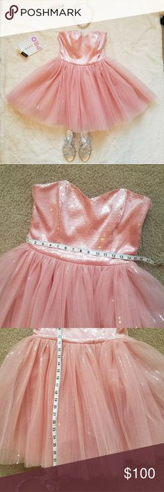 Pink Betsey Johnson Collection tutu dress EUC Let your inner princess show! This dress is stunning and so fun to wear. A layer of tulle covers another layer of tulle with sequin stripes for subtle bling. You can really fluff up the skirt or keep it more demure. Bodice is boned on the front and sides. Fully lined in polyester silk. Side zip. A-line underskirt. Measurements in pictures. Worn once on Halloween (I went as Queen Betsey herself). No signs of wear. This is a quality made dress and…