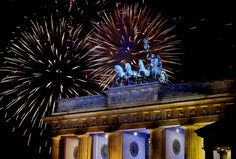 fireworks over a strip mall | Fireworks light the sky above the Quadriga at the Brandenburg Gate in ...