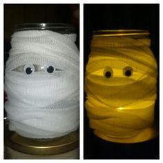 Halloween DIY. Mason jar. Medical gauze. Google eyes. Hot/school glue. Simple & cute!