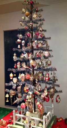 Old blue feather tree with antique glass ornaments
