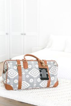 Travel in style with this vintage-inspired bag.