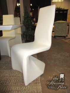 "The Joann side chair in bright white. Similar to our very popular, very modern Elizabeth dining chairs. Excellent choice for a contemporary style table! Four in store at posting, priced separately. 18""W x 19""D x 42""H."