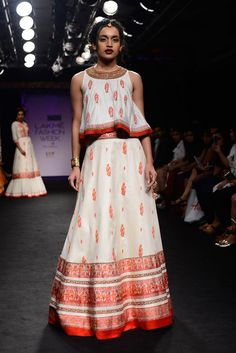 Ivory and red embroidered lehenga set By Sumona Couture