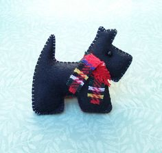 Callum the little Scottie dog, loves wearing his smart new tartan scarf.    He is very well behaved and likes cuddles, treats and long walks!    Callum is made from good quality black wool blend felt and is lightly filled with anti allergen polyester fibre.