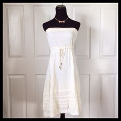 """Cream Strapless Dress Material & Care: • Unknown - Japanese labels  Measurements (approx. laying flat): • Bust (underarm to underarm) - 15""""-19"""" • Waist - 16.5"""" • Length (mid bust to hem) - 32""""  Extras: • Sheer lining • Necklace not included  Condition: • Never worn!!! • No rips, stains or defects  Warning: • Japanese tags/labels  No Trades • Bundle for discounts! • All reasonable offers considered! Dresses Strapless"""