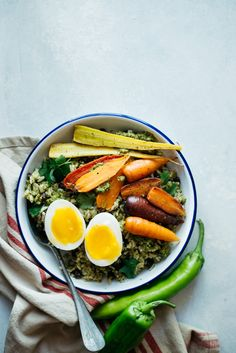 Rice Bowl with Green Pepper Sauce, Roasted Carrots & Eggs - a hearty vegetarian fall meal by @healthynibs