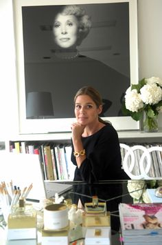 Aerin Lauder with a portrait of her late grandmother Estée hanging behind her.