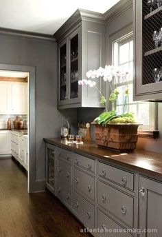 Kitchen: gray cabinets, dark/metallic-y counters