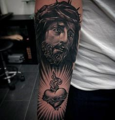 Cool Heart With Jesus Portrait Male Forearm Tattoo Design Ideas