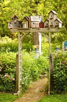 village garden arbor - I just have to do this in my backyard! - Gardening In LightsBirdhouse village garden arbor - I just have to do this in my backyard! - Gardening In Lights Yard Art, The Secret Garden, Secret Gardens, Brick Path, Brick Garden, Wooden Garden, Garden Cottage, Garden Houses, Bird Houses Diy