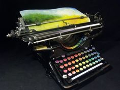 """Say Whattt??   -NPR-  THE CHROMATIC TYPEWRITER  What a lovely new use for an old gadget. Washington-based painter Tyree Callahan has modified a traditional typewriter and turned it into a painting machine, or """"Chromatic Typewriter"""". Callahan submitted the beautiful typewriter as part of the 2012 West Prize competition, an annual art prize that's determined by popular vote. The keys on the vintage 1937 Underwood Standard typewriter have each been replaced with a different pad of color to give…"""