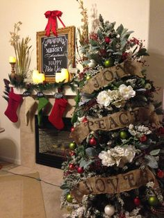 Christmas Decor: Vintage romantic  theme Christmas tree- bought  burlap ribbon-soaked in glue n water mixture then let dry so that the fabric stiffens-stenciled using black permanent marker-bend ribbon to your liking into your tree.