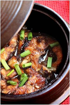 1 lb catfish steaks (bone and skin on or other meaty fish steaks)  4 tbs fish sauce  3 tbs brown sugar  2 tbs minced shallots  2 tbs minced garlic  1 tbs black pepper  3 green onions, sliced 1 inches long  3 tbs caramel sauce (see above)  1 can of young coconut juice  1 thai chili (thinly sliced, optional)  cooking oil