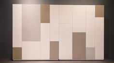 Cobra high wall combination. 8 doors in different sizes. Base is white, combined with 2 extra colors. 306cm wide, 191cm high.  All kind of combinations possible. www.leftlabel.nl