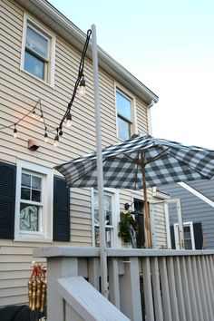 How we hung our Deck String Lights, Privacy Screen and Artwork Outside – Nesting… - Outdoor Rugs On Deck Outdoor Walkway, Stone Walkway, Pergola Patio, Pergola Plans, Outdoor Rugs, Outdoor Decor, Pergola Kits, Pergola Ideas, Patio Seating