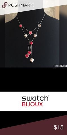 Swatch Bijoux Necklace This necklace is made of 316L stainless steel with red crystals. The strap is a 316L stainless steel ball chain.. Swatch Jewelry Necklaces