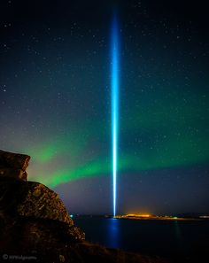 Northern Lights and Peace Tower - This tower of light just outside of Reykjavik (Iceland) is a memorial to John Lennon from his widow, Yoko Ono