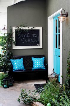 Colorful front door and entryway with chalkboard to greet guests.