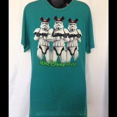 NWOT STORMTROOPERS-Shirt - DISNEY WORLD STAR WARS NWOT STORMTROOPERS WEARING MICKEY MOUSE HATS -Shirt - DISNEY WORLD STAR WARS. Great match for the thin distress style.   Rear inside top around the neck area has 3 small black ink stains, see third picture.  Size men's medium 60% cotton and 40 Polyester, thin lightweight material.  Distress look all over. Disney Parks Tops Tees - Short Sleeve