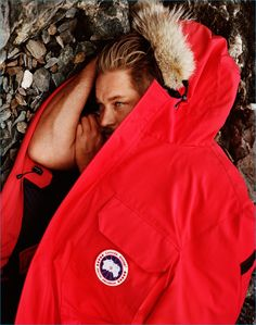 Travis Fimmel retreats into a red jacket for Canada Goose's fall-winter 2016…