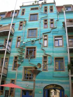A musical wall.  When it rains, it plays, because of the different sizes of funnels and pipes.  How ingenious.