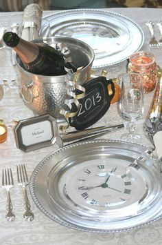 New Year's Eve theme!  I need to find some clip art of clock faces and decopage them to the bottom of clear plates.