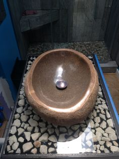 custom made epoxy vanity top with vessel sink river rock and led lights