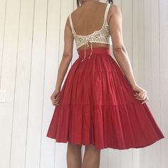 ❤️HP!!!!❤️Red Cotton Vintage Skirt True vintage, tiered cotton, full skirt. This adorable, feminine skirt hits right below the knee and has a size zip and hook and eye closure. The wait measures 25in and the skirt is 26in top to bottom. It will fit a 2/4 best. Vintage Skirts A-Line or Full
