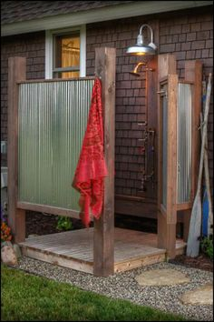 Why shower inside when you can enjoy this! Get more outdoor shower ideas on our site at http://theownerbuildernetwork.co/1drz
