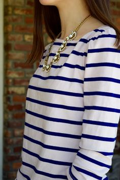 I like this shirt/necklace combo.