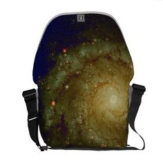 Photograph of a galaxy with yellow and blue tints messenger bag.