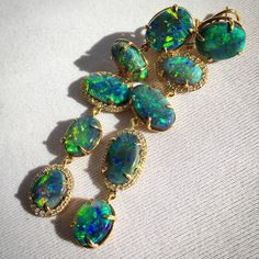 """Lightning Ridge opal earrings by John Ford dance in the sunlight. #opal #earrings #gemobsessed #jewelrydesign #jewelry #gemstones"""