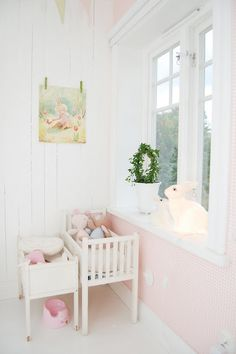 soft pink and white. painted paneling. doll beds. bunny lamp.