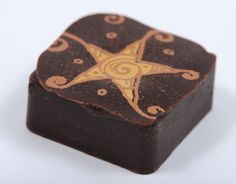 Ah...Star Espresso... Dark, 72% chocolate made from Venezuelan cacao surrounds a delicious ganache of Italian roast espresso, a hint of Kahlua & French wild flower honey.Try it in the Luxx collection $10.00 http://luxxchocolat.com/luxxboxof12.aspx  Repin if this sounds delicious!