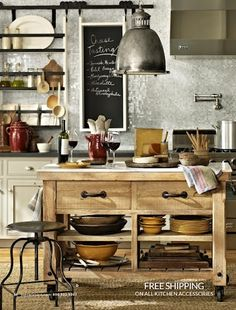 glass tile backsplash, industrial metal open shelving, industrial light, industrial wall water tap, industrial stool, rustic floor & butcher block w open shelves... GENIUS blending of modern and industrial and rustic style. Mad love!