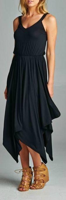 Solid V-neck hanky hem dress. Sleeveless. 96% Modal, 4% Spandex. Made in USA