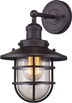 Add a nautical look to any room's décor with this Elk Lighting Seaport Wall-Mount Sconce. The vintage style light features a solid crosshatch patterned steel cage encircling a clear glass, adding an oceanic theme to your décor. Elk Lighting, Wall Sconce Lighting, Outdoor Lighting, Lighting Ideas, Exterior Lighting, Cabin Lighting, Fireplace Lighting, Cottage Lighting, House Lighting
