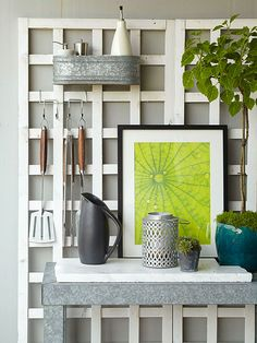 Utilize the walls surrounding a patio and create grilling or garden stations. Use a trellis to hang tools such as trowels or shears. Add a small table to water and store plant materials.