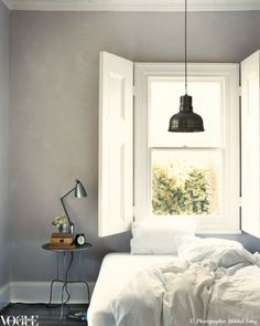 21 dreamy bedrooms to inspire a makeover: A dreamy scenario was created by designer Lyn Gardener in this country retreat outside Melbourne. The pendant light was made from an old industrial lamp, the shutters are recycled doors.