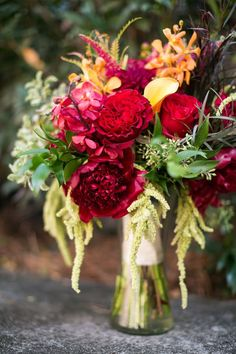 Real wedding inspiration for fall wedding bouquets: bridal bouquet filled with red wedding flowers including red peonies, red roses and orange calla lilies. This peony wedding bouquet would fit in well with garnet jewel tone wedding color palette. Peony Bouquet Wedding, Bridal Bouquet Pink, Red Wedding Flowers, Fall Wedding Bouquets, Bride Bouquets, Wedding Colors, Wedding Dresses, Colorful Wedding Shoes, Red Color Schemes
