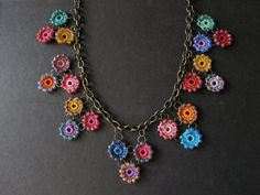 I see these ideas with crochet + chains lately. Awesome stuff and is def easy to make.
