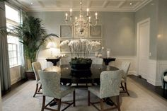light grey walls + wainscot or chair rail + dark wood floors and furniture + soft beige rug + see fan art on the backwall for good measure reminiscent of the restoration hardware art pieces
