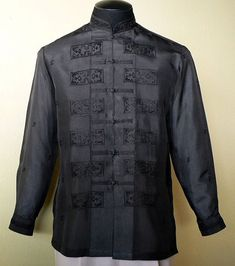 A subtle ethnic pattern and the black color only enhance the superior nature of this high-quality Jusi fabric Tagalog Color: Black Mandarin collar, chinese and cuff buttons Full-open button front Formal fit Filipiniana Dress, Filipiniana Wedding, Wedding Gowns, Barong Tagalog, Debut Dresses, Navy Tuxedos, Chinese Collar, Tropical Fashion, Line Shopping